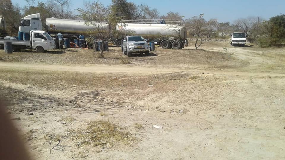 Pictures show fuel tankers offloading fuel in the bush