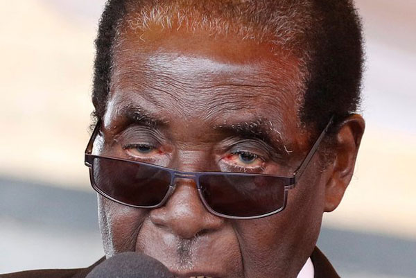 SHOCK As Police Worship Mugabe, Liken Him To God