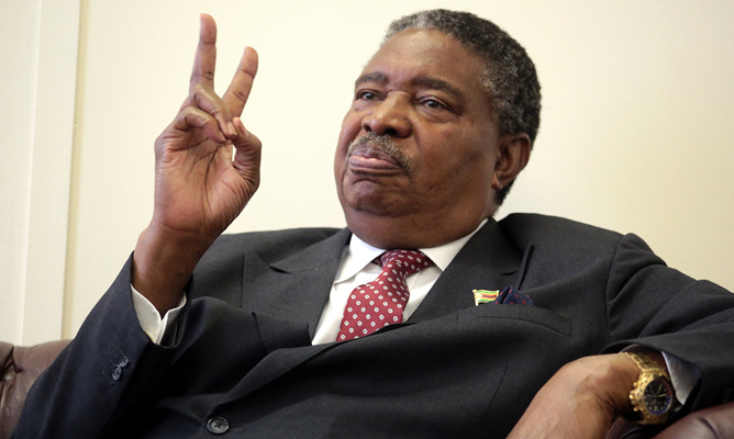 VP Mphoko Under-Fire For Bullying Cops To Release Crime Suspects