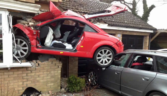 Sports car careers off road and ends up embedded through window of house